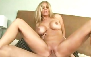 tempting slender blond with large tits rides on