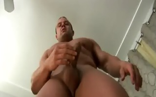 muscular hunk jerks off his hairless hard penis