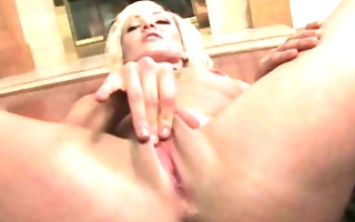 golden-haired playgirl masturbating using her