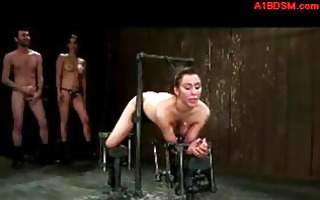 hotty bound to metal frame in doggy getting her