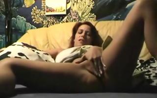 redhead floozy masturbates with a dildo