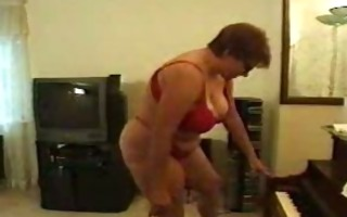 large mature lady acquires drilled at piano lesson