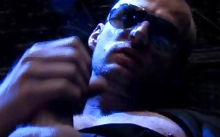 brutal guy in sunglasses jerking off behind bars