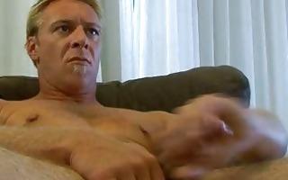 homosexual hunk jerks off on ottoman