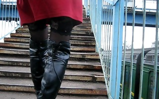 girl in nylons and darksome leather boots going