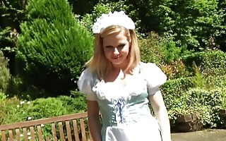 wicked blond in maid uniform undresses outdoor