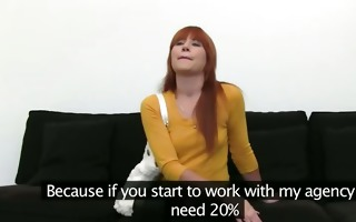 redhead princess teasing on darksome couch