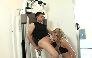 pigtailed golden-haired shoving jock down face